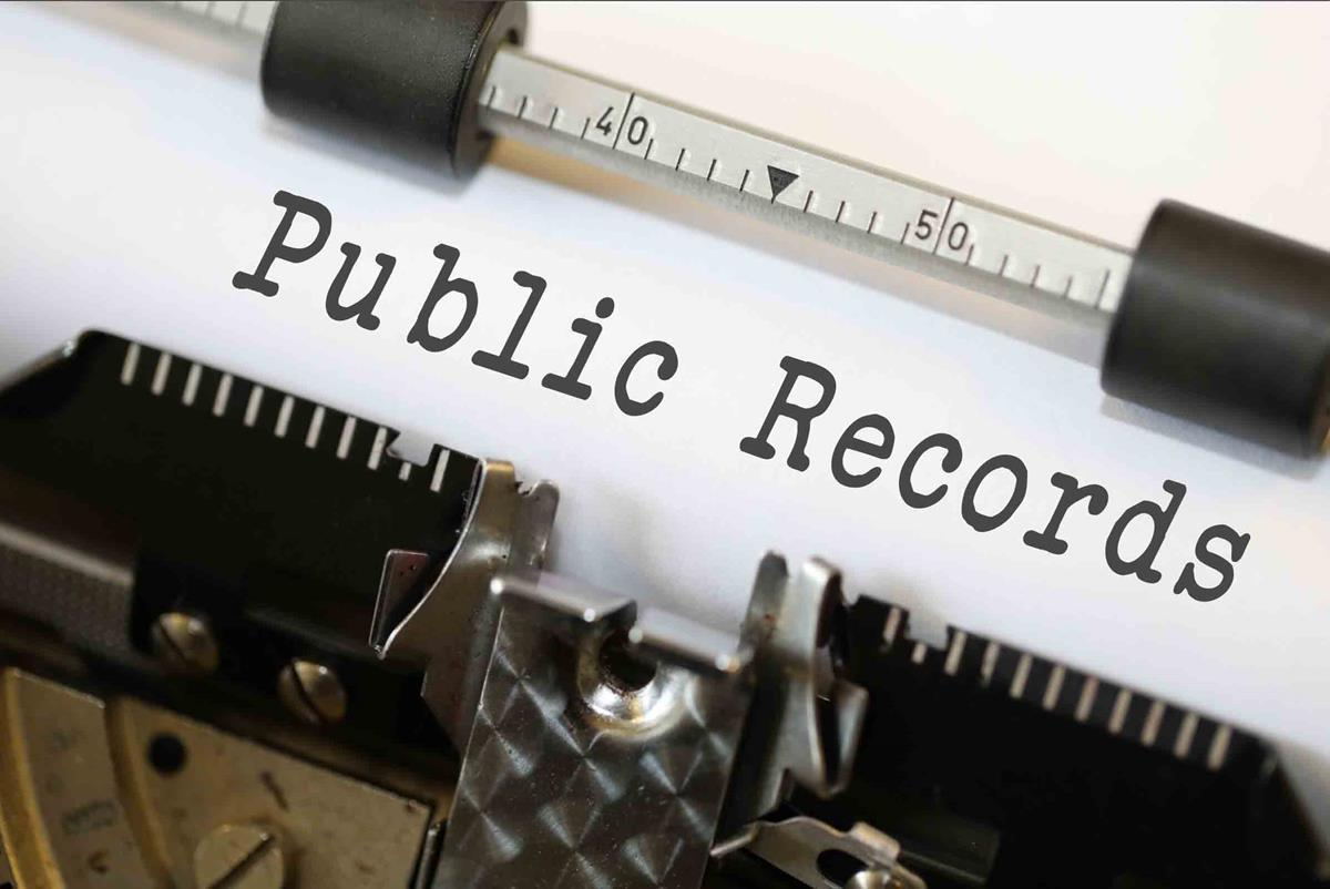 """Graphic displays typewriter with paper reading, """"Public Records"""""""
